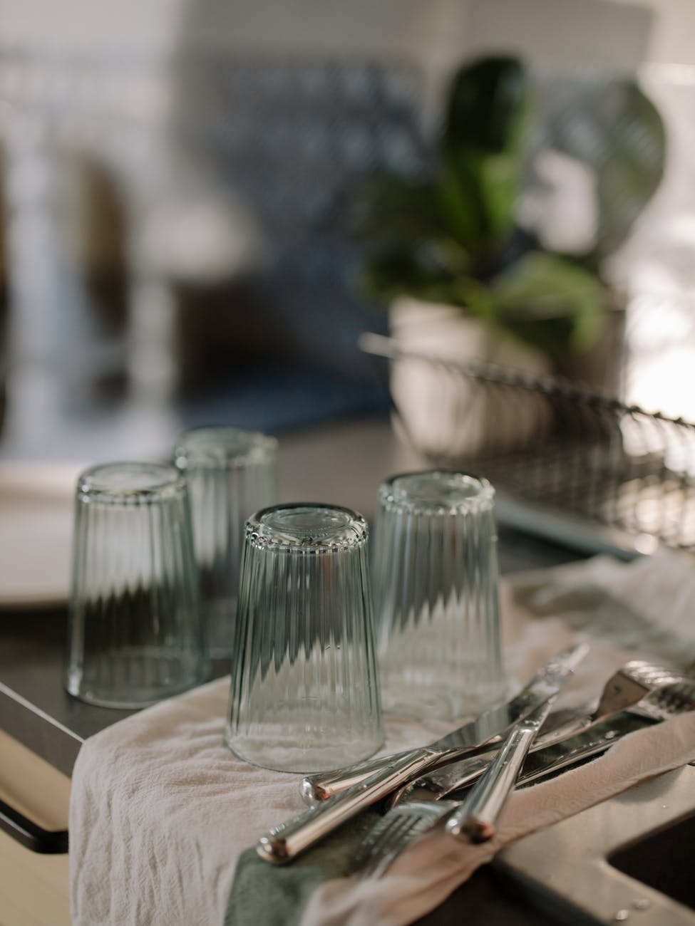clear glass condiment shakers on brown wooden table